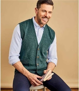 Men's Looks & Outfits: What To Wear In 2020: A dark green sweater vest and navy chinos are an easy way to infuse extra polish into your day-to-day casual wardrobe.