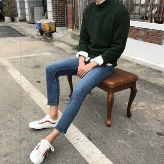 White and Red Leather Low Top Sneakers Outfits For Men: For a cool and casual look, marry a dark green wool turtleneck with blue jeans — these items go pretty good together. A pair of white and red leather low top sneakers will tie the whole thing together.