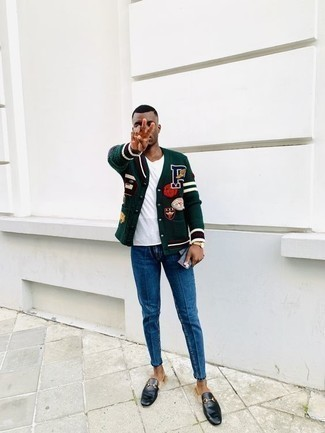 Men's Looks & Outfits: What To Wear In Spring: Why not wear a dark green varsity jacket and blue jeans? As well as super practical, these items look awesome when teamed together. To add a little depth to this getup, add a pair of black leather loafers to the equation. This look is a great pick when spring sets it.