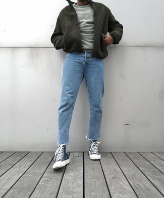 Grey Sweatshirt Outfits For Men: You'll be amazed at how easy it is for any guy to put together this off-duty look. Just a grey sweatshirt paired with light blue jeans. Hesitant about how to round off? Complete your look with navy canvas high top sneakers for a more relaxed twist.
