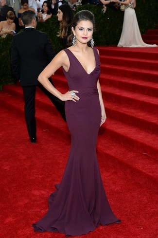 Make a dark purple evening dress your outfit choice to look truly gorgeous.