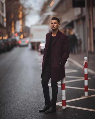 How to wear: dark purple overcoat, black crew-neck sweater, black skinny jeans, black leather chelsea boots
