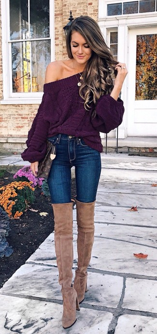 How to Wear Blue Skinny Jeans: Try teaming a dark purple knit oversized sweater with blue skinny jeans for a chic ensemble that's easy to put together. Rev up the cool of this look by finishing with tan suede over the knee boots.