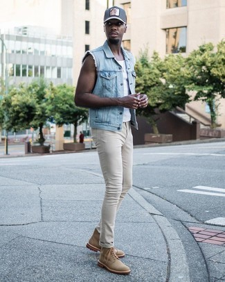 Light Blue Denim Gilet Outfits For Men: You'll be amazed at how super easy it is for any gent to get dressed this way. Just a light blue denim gilet and beige skinny jeans. If you feel like dressing up, introduce tan canvas casual boots to this look.