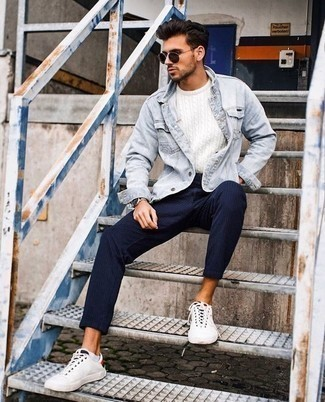 How to Wear a Light Blue Denim Jacket For Men: Who said you can't make a stylish statement with a casual outfit? You can do that efforlessly in a light blue denim jacket and navy vertical striped chinos. When it comes to shoes, this ensemble is completed well with white canvas low top sneakers.