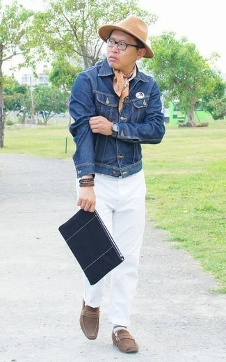 How to Wear a Navy Canvas Zip Pouch For Men: Who said you can't make a stylish statement with a relaxed outfit? You can do that easily in a blue denim jacket and a navy canvas zip pouch. To add some extra depth to this ensemble, rock a pair of brown suede loafers.