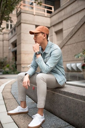 How to wear: light blue denim jacket, beige chinos, white leather low top sneakers, orange baseball cap