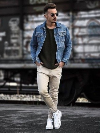 How to Wear a Blue Denim Jacket For Men: This combo of a blue denim jacket and beige jeans is very easy to assemble and so comfortable to sport from dawn till dusk as well! Complete this ensemble with a pair of white canvas high top sneakers to bring a sense of stylish effortlessness to your look.