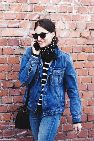 How to wear: blue denim jacket, black and white horizontal striped crew-neck sweater, blue jeans, black suede bucket bag
