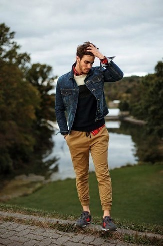 How to Wear a Navy Denim Jacket For Men: A navy denim jacket looks especially great when paired with khaki chinos in an off-duty outfit. Charcoal athletic shoes add a little edge to an otherwise sober ensemble.
