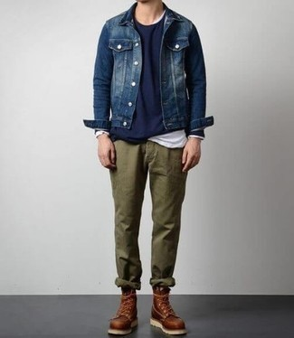 Which Work Boots To Wear With a Blue Denim Jacket For Men: This pairing of a blue denim jacket and olive chinos is solid proof that a safe casual outfit can still look really interesting. Loosen things up and complement this getup with work boots.