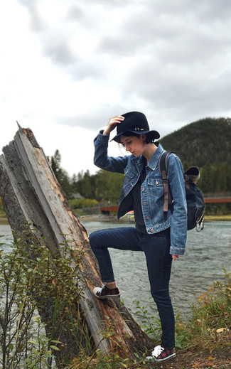 This combination of a blue trucker jacket and navy slim jeans is incredibly stylish and yet it looks comfortable and ready for anything. For the maximum chicness throw in a pair of red plaid low top sneakers. We promise this getup is the answer to all of your transeasonal style problems.