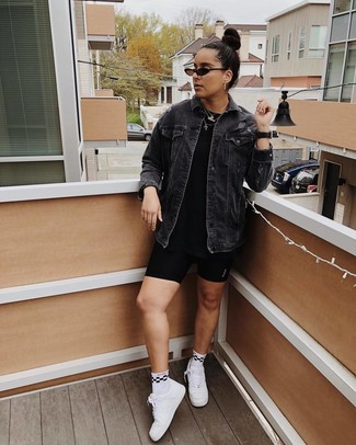 How to wear: black denim jacket, black crew-neck t-shirt, black bike shorts, white leather low top sneakers