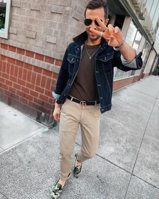 How to wear: navy denim jacket, charcoal crew-neck t-shirt, beige chinos, dark green camouflage slip-on sneakers