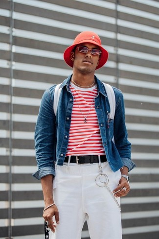 How to Wear a Bucket Hat For Men: A blue denim jacket and a bucket hat are an urban pairing that every modern gentleman should have in his casual styling collection.