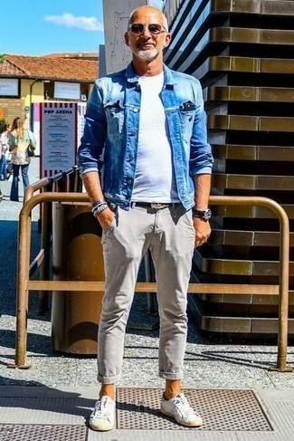 How to Wear Chinos: For practicality without the need to sacrifice on style, we love this pairing of a blue denim jacket and chinos. And if you want to instantly dress down this outfit with footwear, complement this ensemble with white leather low top sneakers.