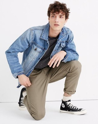 How to Wear Black and White Canvas High Top Sneakers For Men: Showcase that you do off-duty like a fashion pro in a blue denim jacket and brown chinos. Complement this outfit with a pair of black and white canvas high top sneakers to avoid looking too formal.