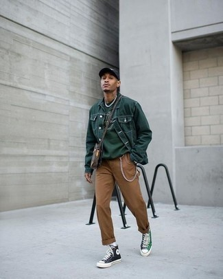 Dark Brown Leather Messenger Bag Outfits: Try teaming a dark green denim jacket with a dark brown leather messenger bag to put together a really sharp and urban ensemble. Let your expert styling really shine by completing this ensemble with dark green canvas high top sneakers.