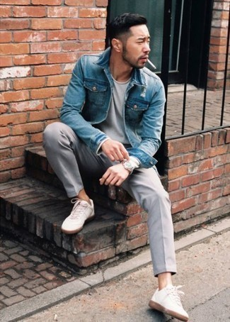 How to Wear a Blue Denim Jacket For Men: For a laid-back and cool ensemble, consider teaming a blue denim jacket with grey chinos — these two pieces go really well together. For a truly modern hi/low mix, complement your look with white canvas low top sneakers.