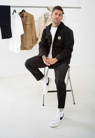How to Wear a Jacket For Men: A jacket and black chinos are must-have menswear items, without which our wardrobes would definitely feel incomplete. Finishing off with a pair of white and black canvas high top sneakers is a guaranteed way to infuse a more casual vibe into your look.
