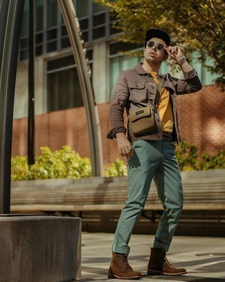 Men's Outfits 2020: Show that you know a thing or two about men's style by opting for a brown denim jacket and mint chinos.