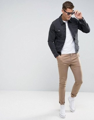 White Canvas High Top Sneakers Outfits For Men: Marry a black denim jacket with khaki chinos for both dapper and easy-to-achieve outfit. If you want to effortlessly play down this getup with one single piece, complement this ensemble with white canvas high top sneakers.