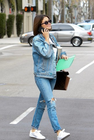 Pair a light blue denim jacket with light blue ripped jeans for a casual get-up. White leather low top sneakers complement this ensemble quite well. You can bet this getup is great come warmer weather.