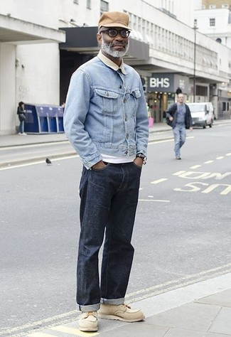 How to Wear a Light Blue Denim Jacket For Men: For something more on the casually edgy end, try this combo of a light blue denim jacket and navy jeans. Finishing off with beige leather work boots is an easy way to inject a more relaxed vibe into this ensemble.