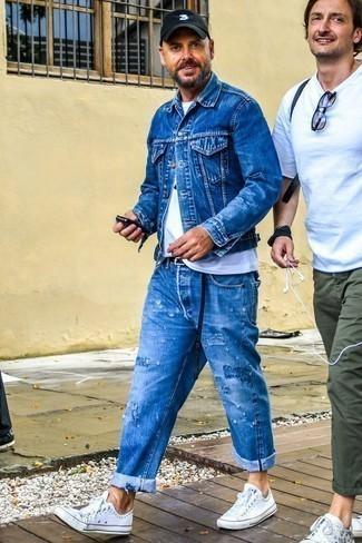 How to Wear a Blue Denim Jacket For Men: This getup with a blue denim jacket and blue ripped jeans isn't hard to put together and is open to more creative experimentation. If you want to instantly lift up your ensemble with shoes, why not introduce white canvas low top sneakers to the mix?