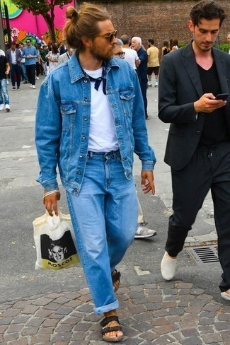 How to Wear Jeans For Men: Marrying a blue denim jacket with jeans is an amazing pick for a casual ensemble. Add a more informal twist to an otherwise traditional outfit by finishing with a pair of black leather sandals.