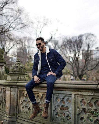 How to Wear a Navy Denim Jacket For Men: This pairing of a navy denim jacket and navy jeans delivers comfort and dapper menswear style. For something more on the dressier side to round off this ensemble, complete this ensemble with a pair of brown suede casual boots.