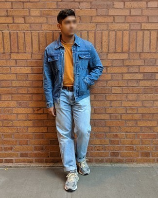 Blue Denim Jacket Warm Weather Outfits For Men: This off-duty combo of a blue denim jacket and light blue jeans is a safe option when you need to look nice but have no extra time. Bump up this whole look by finishing off with a pair of grey athletic shoes.