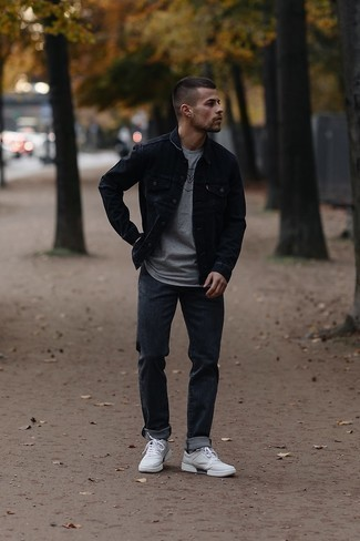 Charcoal Jeans Outfits For Men: Why not marry a black denim jacket with charcoal jeans? These two items are totally functional and will look great combined together. Let your sartorial chops really shine by finishing your look with a pair of white canvas low top sneakers.