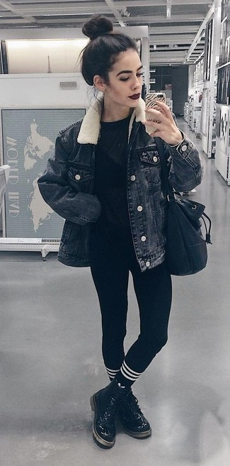 How to wear: black denim jacket, black crew-neck t-shirt, black leggings, black leather lace-up flat boots