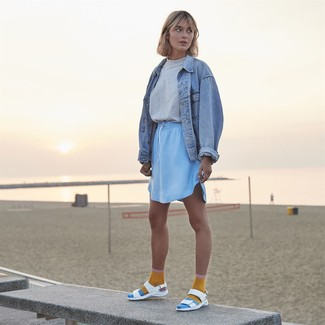 How to wear: light blue denim jacket, grey crew-neck t-shirt, light blue mini skirt, white leather flat sandals