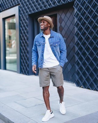 Bucket Hat Outfits For Men: Extremely stylish and practical, this pairing of a blue denim jacket and a bucket hat provides variety. Let your sartorial savvy truly shine by complementing your look with white and navy canvas low top sneakers.