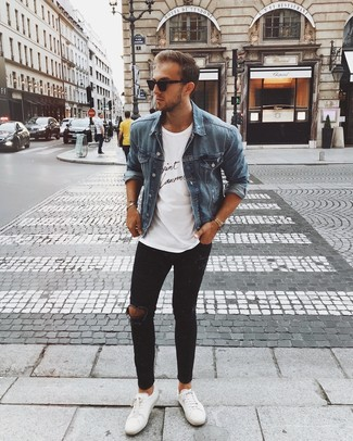 How to Wear a Blue Denim Jacket For Men: If you gravitate towards relaxed dressing, why not marry a blue denim jacket with black ripped skinny jeans? White leather low top sneakers are an effective way to punch up your ensemble.