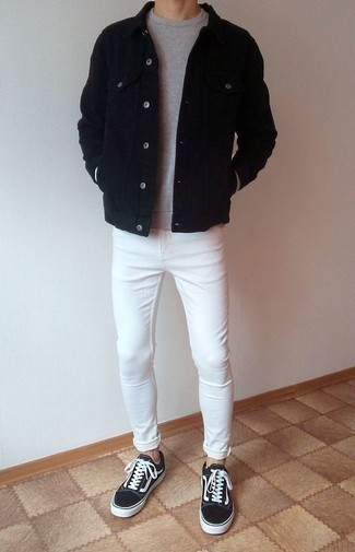 How to Wear White Skinny Jeans For Men: If you feel more confident in practical clothes, you'll appreciate this on-trend combo of a black denim jacket and white skinny jeans. A pair of black and white canvas low top sneakers will tie the whole thing together.