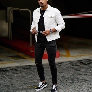 Black Ripped Skinny Jeans Outfits For Men: If you enjoy a more casual approach to dressing up, why not dress in a white denim jacket and black ripped skinny jeans? Introduce a pair of black and white canvas low top sneakers to the mix to easily ramp up the wow factor of this look.