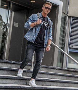 Black Leather Backpack Outfits For Men: You'll be amazed at how easy it is for any man to get dressed like this. Just a blue denim jacket married with a black leather backpack. Complement your outfit with white leather low top sneakers to serve a little mix-and-match magic.