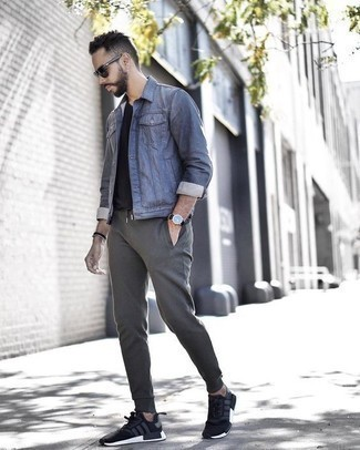 How to Wear a Blue Denim Jacket For Men: This ensemble with a blue denim jacket and grey sweatpants isn't hard to score and is open to more experimentation. Complement this getup with black and white athletic shoes to instantly dial up the style factor of your outfit.