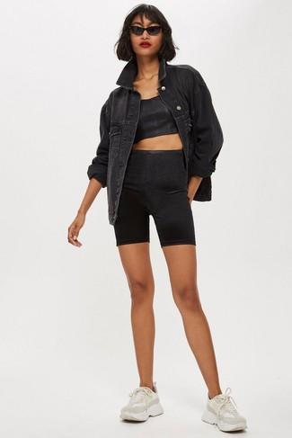 How to wear: black denim jacket, black cropped top, black bike shorts, beige athletic shoes