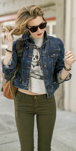 Stand out among other stylish civilians in a dark blue denim jacket and dark green skinny jeans.