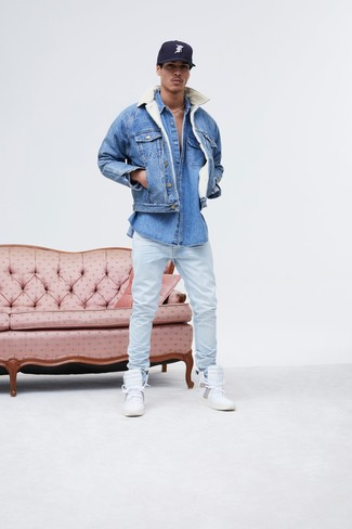 How to wear: blue denim jacket, blue denim shirt, light blue jeans, white leather high top sneakers