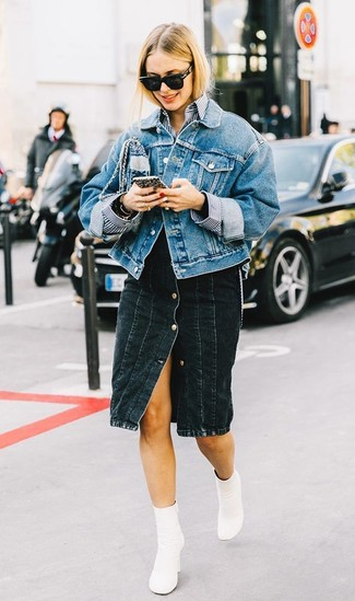 How to wear: blue denim jacket, white and navy vertical striped dress shirt, black denim button skirt, white leather ankle boots