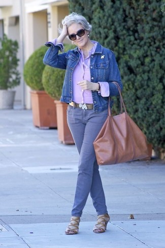 Purple Jeans Outfits For Women: For a totaly stylish outfit without the need to sacrifice on functionality, we love this combination of a blue denim jacket and purple jeans. A pair of brown leather heeled sandals will bring a sophisticated aesthetic to the getup.