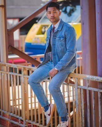 Light Blue Jeans with White Shirt Outfits For Men: This combination of a white shirt and light blue jeans is undoubtedly a statement-maker. To bring a little zing to this outfit, add white and red canvas low top sneakers to the mix.
