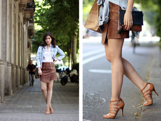 How to wear: light blue denim jacket, white dress shirt, brown leather mini skirt, brown leather gladiator sandals