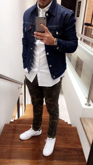 How to Wear Olive Camouflage Jeans For Men: If you feel more confident in practical clothes, you'll love this stylish pairing of a navy denim jacket and olive camouflage jeans. Our favorite of an endless number of ways to round off this ensemble is with a pair of white leather low top sneakers.
