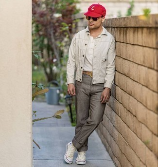 Beige Canvas High Top Sneakers Outfits For Men: For a sharp ensemble without the need to sacrifice on comfort, we turn to this combo of a white denim jacket and grey vertical striped chinos. And if you need to instantly dial down this getup with a pair of shoes, why not complement this ensemble with beige canvas high top sneakers?